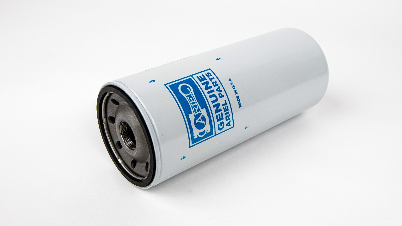 An ariel spin-on oil filter on a white background