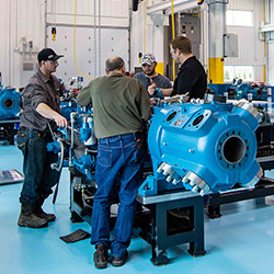 Ariel Employees working on and Ariel Compressor
